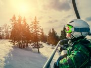 Little skier on the ski lift